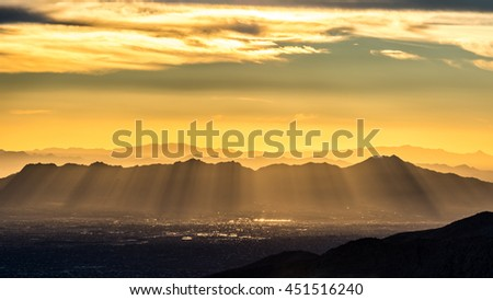 Sunset with God rays over Tucson Mountains