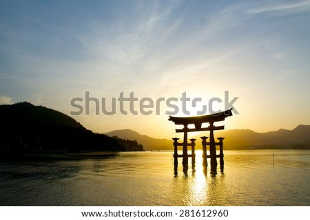sunset with Japan gate (O-Torii) in Miyajima - stock photo