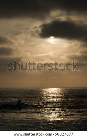 sunset with lone surfer
