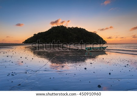 Sunset with reflection at Kelambu Beach Kudat Sabah Malaysia. Image contain soft focus and blur. - stock photo