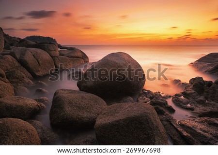 Sunset with rock and beach in Phuket island, Thailand - stock photo