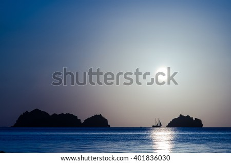 Sunset with sailboat silhouette (Shift White balance) - stock photo