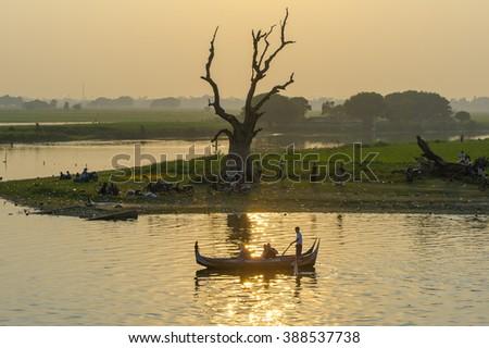 Sunset with silhouette of u bein bridge in myanmar - stock photo
