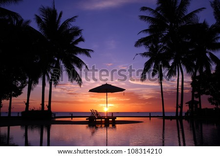 Sunset with silhouettes - stock photo