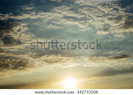 Sunset with sun rays and clouds, instagram cold toning