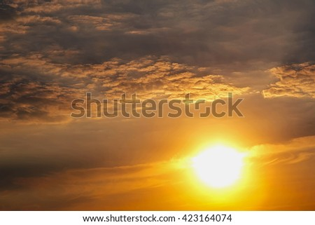 Sunset with sun rays and clouds, instagram warm toning