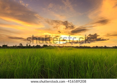 Sunset with sun rays shining through the beautiful clouds - stock photo