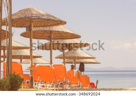Sunshade and Chair On The Beach over blue summer sky. - stock photo