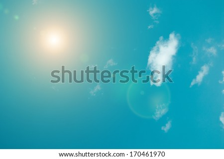 Sunshine and blue sky with flares - stock photo