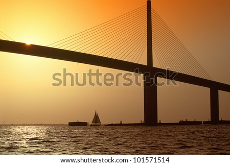Sunshine Bridge at Tampa Bay and St. Petersburg, Florida at sunset - stock photo