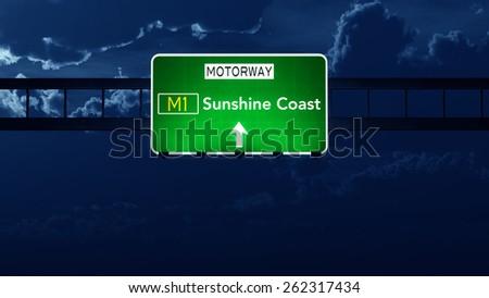 Sunshine Coast Australia Highway Road Sign at Night - stock photo