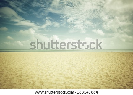 Sunshine on empty beach - stock photo