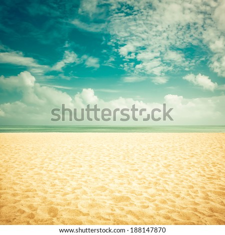Sunshine on empty beach - vintage look - stock photo