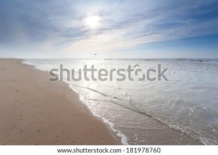 sunshine over sand beach in North sea, Zandvoort aan Zee, North Holland - stock photo