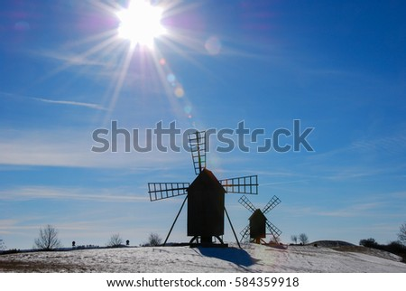 Sunshine over two old windmills at the island Oland in Sweden.