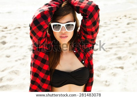 Sunshine portrait of glamour,stylish teenager wear fashion reflecting sunglasses,looking at camera.Outdoor lifestyle summer stunning fit woman.Sunbathing,casual summer outfit,cool and fashion woman - stock photo