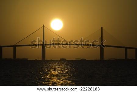 Sunshine Skyway Bridge at sunrise over Tampa Bay. - stock photo