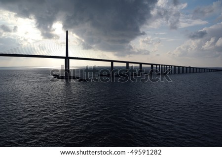 Sunshine Skyway Bridge shot from the water- Spanning Tampa Bay south of St. Petersburg - as storm clouds clear - stock photo