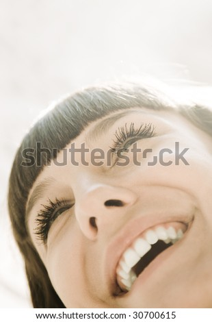 sunshine smile (special light volume photo f/x, toned, focus point on eye) - stock photo