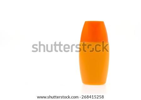 Suntan lotion cream bottle isolated on white background - stock photo