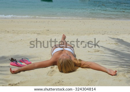 Suntanning on beach in Thailand - stock photo