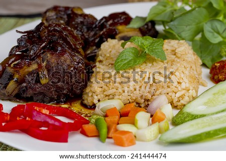 sup iga bakar dan nasi goreng, fried rice and grilled ribs soup, Indonesian cuisine - stock photo