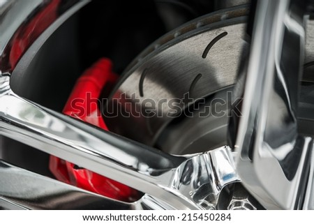 Super Car Brakes. Disc Brake. Disc Pads, Wheel Bearing, Caliper Assembly. Car Brakes Closeup Photo. - stock photo