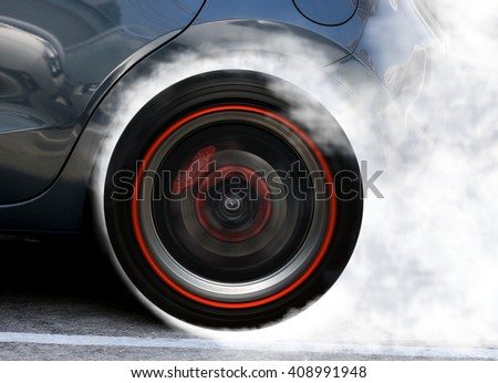 Super car wheel drifting and smoking on track - stock photo