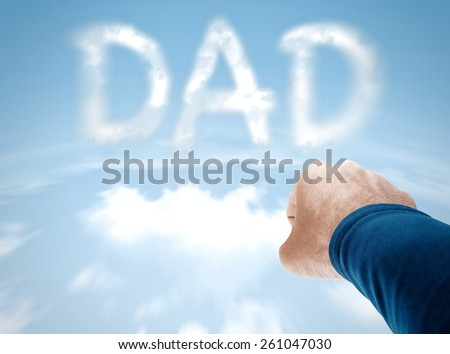 Super dad concept with superman arm flying towards clouds spelling DAD - stock photo