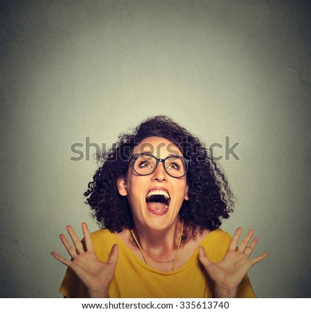 super excited funky girl looking up isolated on grey wall background - stock photo