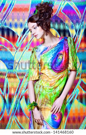 Super extra colorful portrait beautiful girl in bright green dress on pattern background - stock photo