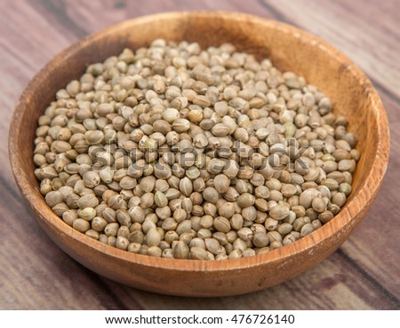 Super food hemp seed in wooden bowl over wooden background