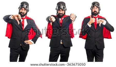 Super hero businessman doing bad signal - stock photo