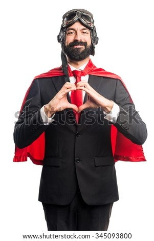 Super hero businessman making a heart with his hands - stock photo