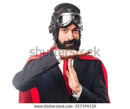 Super hero businessman making time out gesture - stock photo