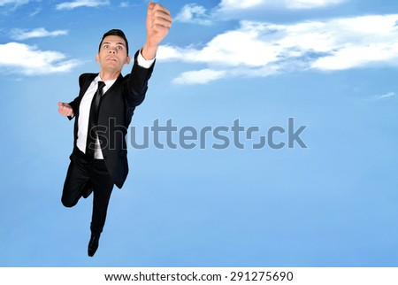 Super hero concept of business man fly - stock photo