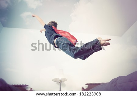 Super hero flying into imagination - stock photo