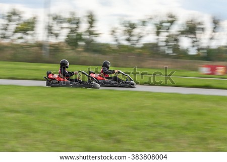 Super kart racing team. The racer on carting. Two Races on cartings. Races on a cross-country terrain. Cars races. Races on long exposure.  - stock photo