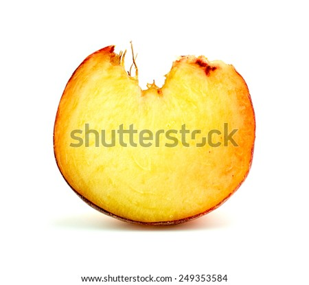 Super macro closeup of cross section of vibrant donut peach fruit - stock photo