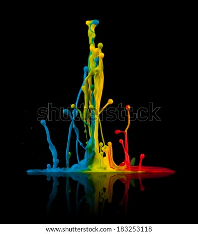 """Super macro shot of colored paint splashes """"dancing"""" on sound waves, isolated on black background - stock photo"""