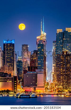 Super Moon rise above the midtown Manhattan skyscrapers - stock photo