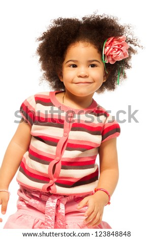 Super nice little black girl with curly hair portrait