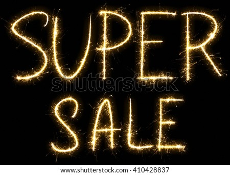 Super Sale text made of sparkler. Isolated on a black background