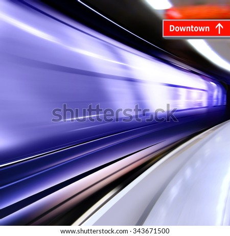 super streamlined train with motion blur moves in subway - stock photo