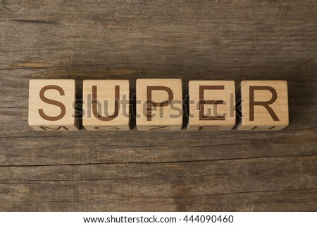 super word written on wooden cubes - stock photo
