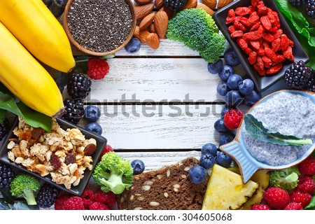 Superfood. Frame of healthy vegan ingredients on white wooden board. Healthy food concept.