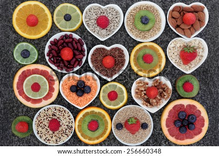 Superfood selection in abstract design over marble background. - stock photo
