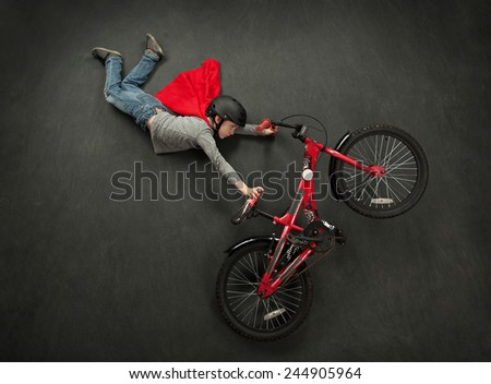 Superhero bike jump boy - stock photo