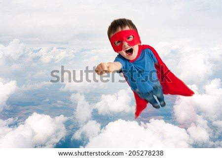 superhero boy child flying upwards through the clouds