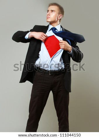 Superhero businessman, isolated on grey backgroound - stock photo